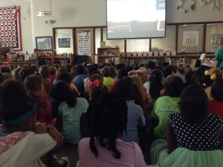2nd grade students watching Sciencepalooza virtually on the projection screen